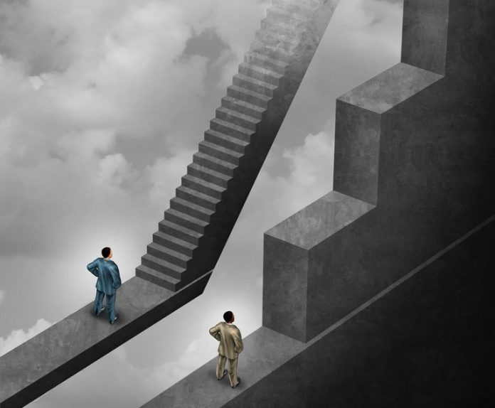 A white man before stairs that are easy to climb. A black man before stairs that are hard to climb. Photo: Lightspring/Shutterstock