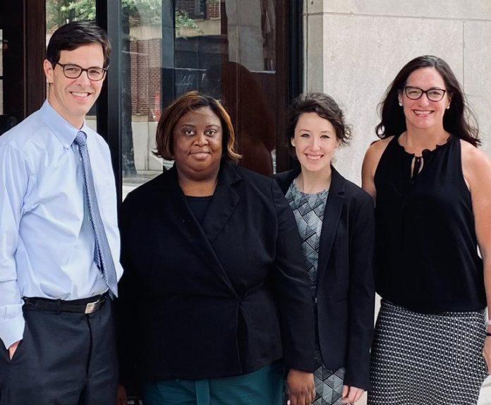 John Stembridge (from left), plaintiff Crystal Lamb, paralegal Victoria Engleman and Lisa Taylor. (Courtesy photo)